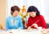 adult woman with special needs are engaged in handcraft in rehabilitation center poster