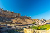 The impressive landscape and cityscape at Amber Fort famous travel destination in Jaipur Rajasthan India. Wide angle view from below. poster