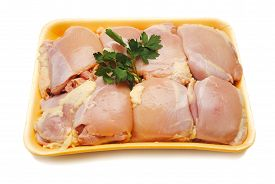 Packaged Raw Boneless Chicken Thighs Garnished with Parsley