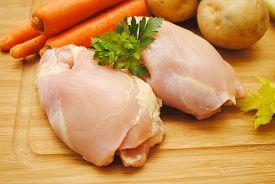 Raw Boneless Chicken Thigh with Fresh Ingredients