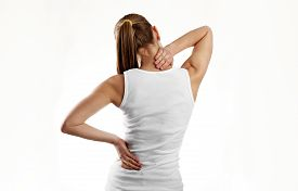 Nape pain. Backache. Stressed female massaging her painful body.