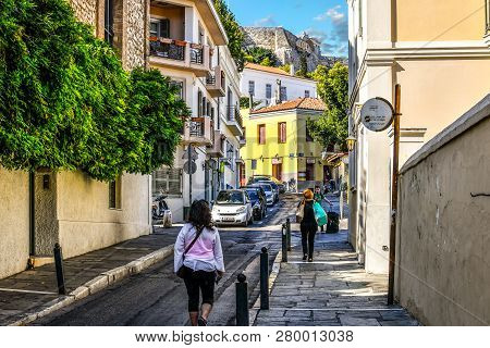 Athens, Greece - September 15 2018: Local Greeks Walk Through A Residential Neighborhood Near The Pl