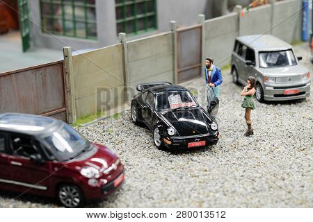 Wroclaw, Poland - December 12, 2018: Maquette Or Miniature Of Young Girl Buying A Used Car. On Banne