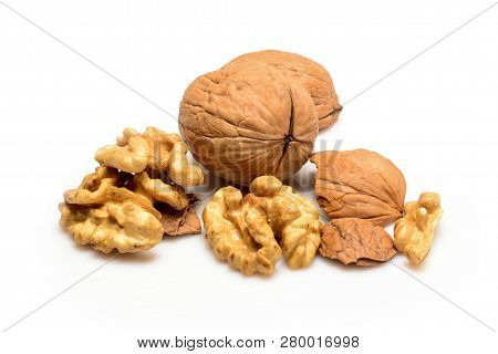 Walnuts And Kernels, Whole Walnut And Kernels, Close-up Macro, Isolated On A White Background.