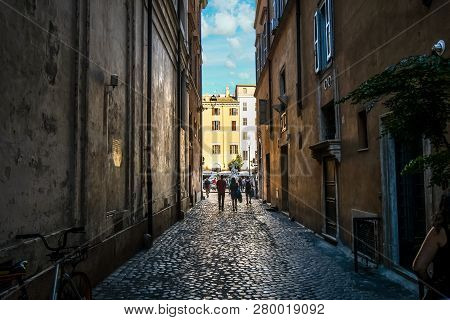 Rome, Italy - September 31 2018: A Couple Walks Down A Narrow Alley Towards The Piazza Navona In Rom