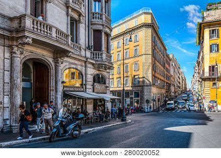 Rome, Italy - September 29 2018: Tourists Enjoy Lunch At A Sidewalk Cafe On A Busy Intersection In T