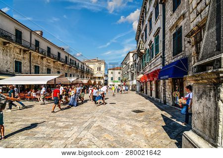 Kotor, Montenegro - September 20 2018: A Young Woman Selling Souvenirs Takes A Cigarette Break In Th