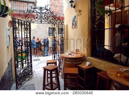 Malaga, Spaine - Nov 23: Outdoor Cafe With People Having Dinner On Street With Traditional Spanish H