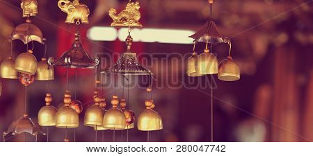 poster of Feng Shui chimes hanged outside the house for protection and good luck