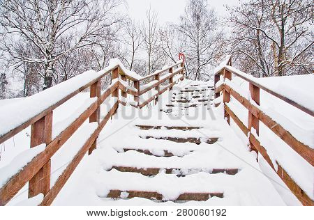 Stairs Under Snow In A Park In Winter