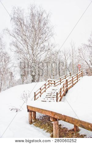 Staircase Under Snow In A City Park In Winter