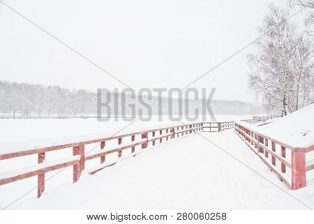 Wooden Fence In The City Park In Winter