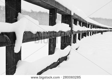 Wooden Fence In The City Park In Winter Black And White