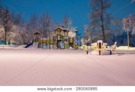 Playground And Carousel In The Evening Winter Park