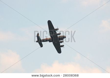 EASTBOURNE, ENGLAND-AUGUST 16: A World War Two, Avro Lancaster bomber aircraft gives a display on August 16, 2009 in Eastbourne, Sussex.