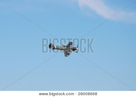 EASTBOURNE, ENGLAND - AUGUST 14: A second world war Hawker Hurricane fighter performs at the Airbourne airshow on August 14, 2010 at Eastbourne, East Sussex. This example was built in 1940 in Canada.