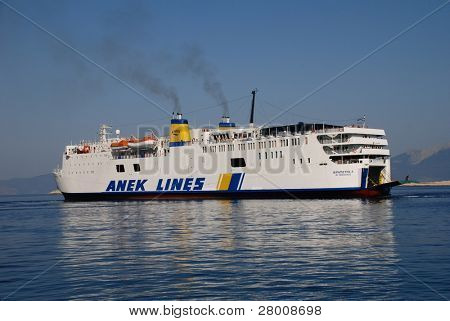 HALKI, GREECE - JUNE 14: ANEK Lines ship the Ierapetra L. approaches Emborio harbour on June 14, 2010 in Halki island, Greece. Founded in 1967 in Crete, ANEK now operates a fleet of eleven ships.