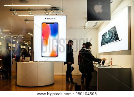 Barcelona, Spain - Nov 11, 2018: Young Customers Inside Apple Store Authorised Reseller In Central B