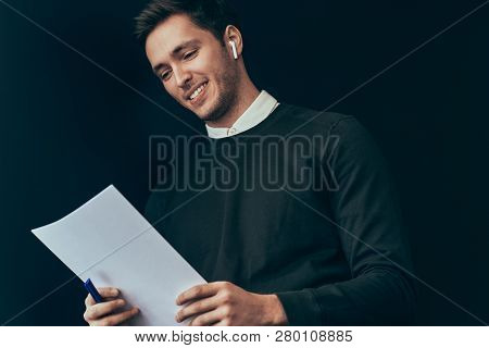Happy Young Handsome Man Smiling And Reading Information From Documanet And Have A Conversation From