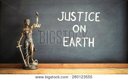 Justice On Earth Concept With Statue Of Lady Justice