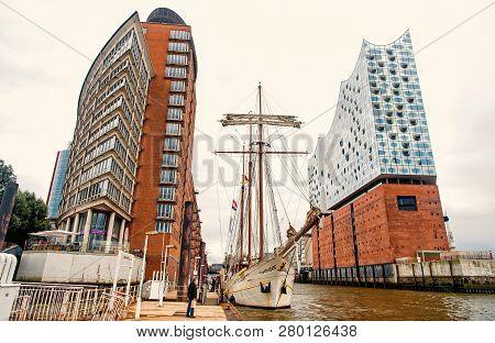 Hamburg, Germany - September 07, 2017: Yacht And Philharmonic Concert Hall On Elbe River On Urban Ba