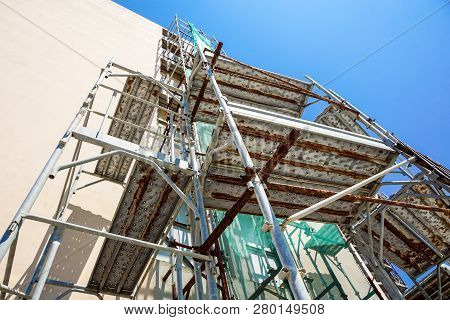 Scaffolding System In Construction. Scaffolding On A Construction Site