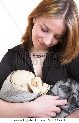 young woman in black dress with cranium in the hand