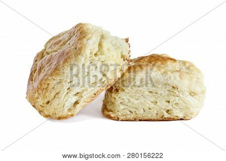 Two Buttermilk Southern Biscuits Or Scones Isolated Over A White Background With Light Shadow And Cl