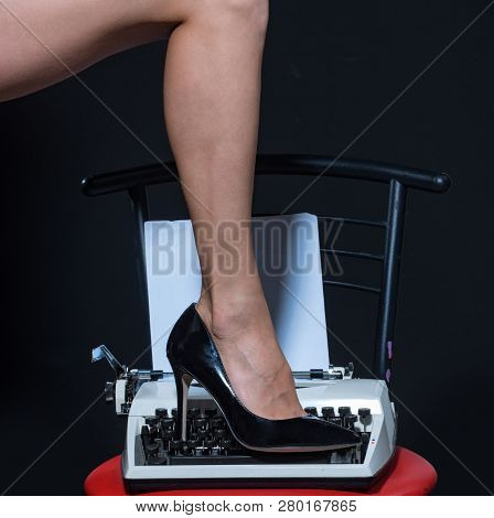 Sexy Legs. Retro Typewriter. Modern Fashion. Fetish Wear Shoes On Leg Of Woman. Seducing You. Love E