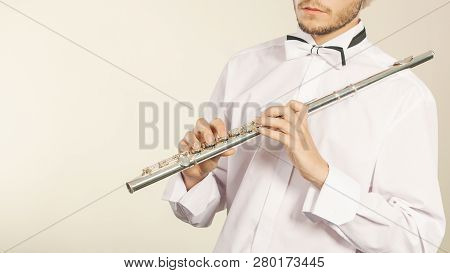 Flute Music Playing Professional Male Flutist Musician Performer. Young Elegant Guy Holding Instrume