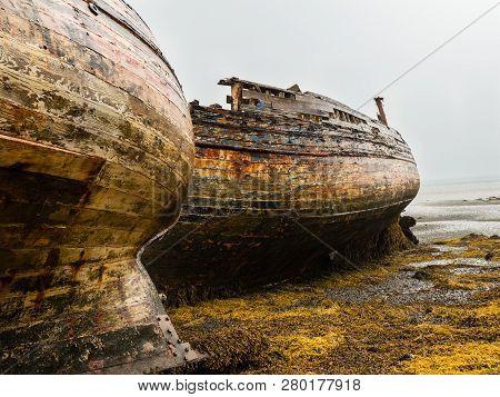 Shipwrecked Fishing Boats On The Scottish Isle Of Mull