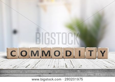 Commodity Sign On A White Desk In A Bright Room In Daylight