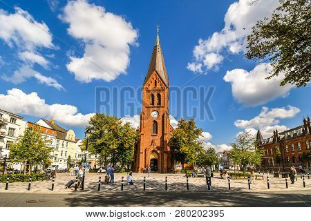 Warnemunde, Rostock, Germany - September 5 2018: The Neogothic Warnemunde Church Tower Rises Above T