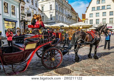 Tallinn, Estonia - September 13 2018: A Horse Carriage And Rider For Hire Ride Into The Town Square