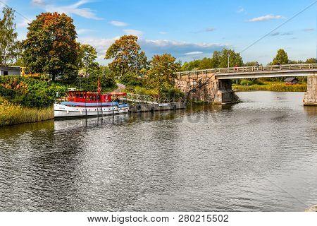 Porvoo, Finland - September 10 2018: A Boat Docks Along The Banks Of The Porvoonjoki River As Visito