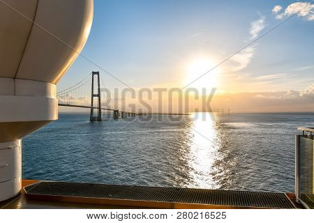 View Of The Setting Sun Over The Oresund Bridge Which Spans The Strait Between Sweden And Denmark Fr