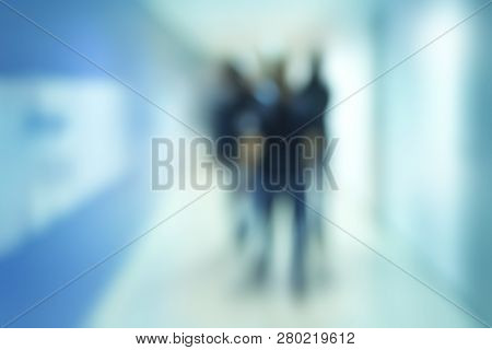 Abstract Blur People Background, Silhouettes Of Unrecognizable People Walking In A Hallway