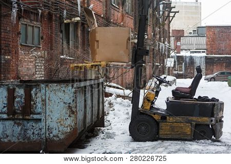 Yellow Loader Loads Garbage In Large Trash Can/the Driver Left His Vehicle And Left For Help, Indust