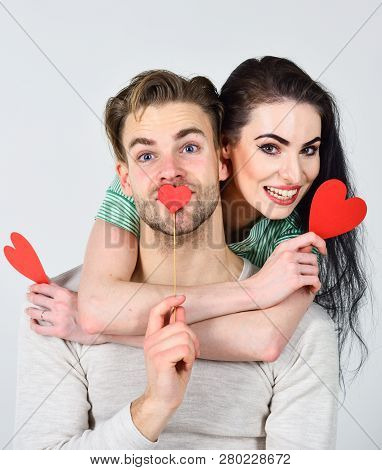 Man And Woman Couple In Love Hug And Hold Red Heart Valentines Cards Close Up. Valentines Day Concep