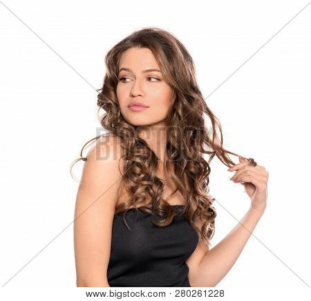 Portrait Of Beautiful Young Woman With Shiny Wavy Hair On White Background