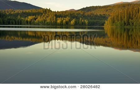 Silent mountain lake in mountains of Canada