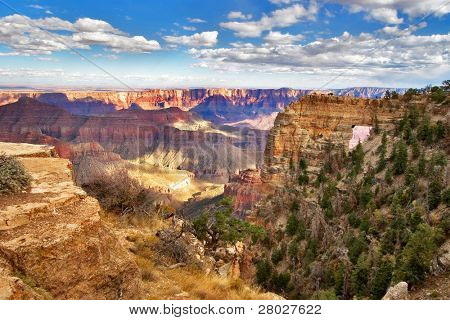 An arch in a ledge of the Grand Canyon in the USA poster