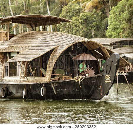Alleppey, India, Mar 13, 2018: Bamboo Thatched Houseboat Floats Down The Backwaters Of Kerala In The