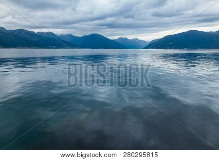 Calm morning on Sognefjord or Sognefjorden (the King of the Fjords), the largest and deepest fjord in Norway. Vik municipality, Sogn og Fjordane, Norway, Scandinavia