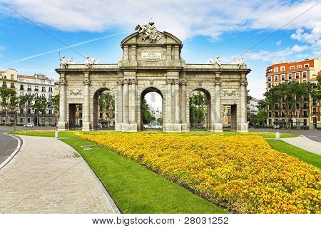 Magnificent flower beds before the Royal Triumphal arch in Madrid