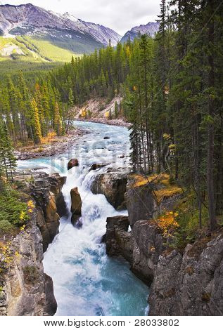 A falls in a narrow and deep canyon in the north of Canada