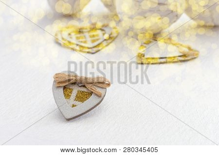 A Small Homemade Carton Heart With Gold Sparkles On A White Background With Gold Boke. Light Fon Wit