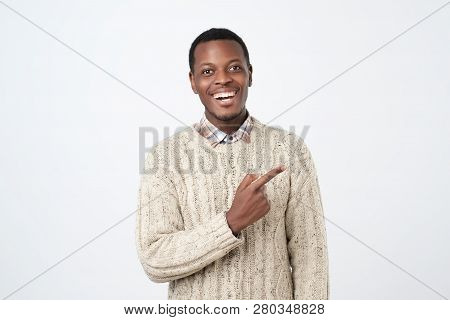 Look Over There. Happy Young Handsome African Man Pointing Away And Smiling