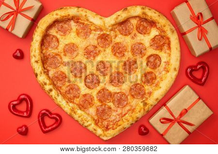 Pizza Shape Heart Pizza Pepperoni For Valentines Day With Gift Box On Red Paper Background.