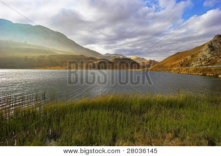 Mountain lake in the Swiss Alps in cloudy autumn day